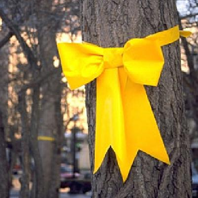 yellow ribbon on old oak tree